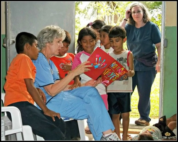 Reading a book to the kids while family members received care.